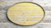 Old elliptic wooden sign on wood wall background — Stock Photo