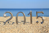 Year 2015 number on the beach — Stock Photo
