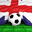 Soccer ball with British flag on football field closeup — Stock Photo #47932239