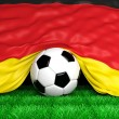 Soccer ball with German flag on football field closeup — Stock Photo #47932245