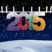 Number 2015 hanging on a clothesline in a night wintry background — Stock Photo