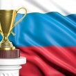 Golden trophy with Russian flag in background — Stock Photo
