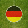 Football field center closeup with German flag in circle  — Stock Photo #49385097