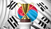 Golden trophy with South Korean flag in background — Stock Photo