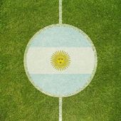 Football field center closeup with Argentinian flag in circle  — Stock Photo