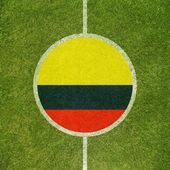 Football field center closeup with Colombian flag in circle  — Stock Photo