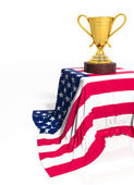 Golden trophy with American flag isolated on white — Stockfoto