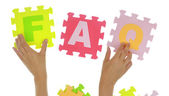 """Hands forming word """"Faq"""" with jigsaw puzzle pieces isolated  — Stock Photo"""