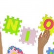 """Hands forming word """"Union"""" with jigsaw puzzle pieces isolated — Stock Photo"""
