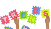 """Hands forming word """"Trends"""" with jigsaw puzzle pieces isolated — Stock Photo"""