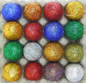 Colorful glitter eggs in carton egg packaging  — Stock Photo
