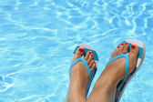 Female wet feet with flip flops by the pool  — 图库照片