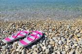 Flip flops on pebbled beach closeup Vassiliki Lefkada  — Stock Photo