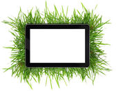 Tablet with blank white screen surrounded by grass isolated — Stock Photo