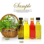 Fresh herbs in wicker basket, essential oils and herbal essences  — Stock Photo