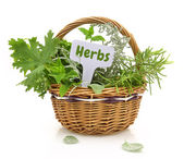 Fresh herbs in wicker basket with a tag — Stock Photo