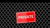 Metal fence with red sign Private isolated on black — Stock Photo