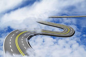 Road up in the blue sky over the clouds — Stock Photo