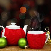 Christmas decoration, teapot and cup in front of sparkle lights — Stock Photo