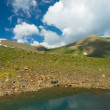 Small mountains with Colorful Lake and dark blue sky and clouds — ストック写真