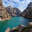 Kelsu mountain lake with turquoise colour of water and wonderful rocks and blue sky with clouds. — Stock Photo #30003793