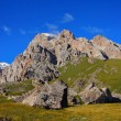 Small mountain against the background of amazing blue sky with clouds — Stock Photo #30004931