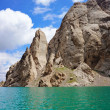 Amazing Kelsu mountain lake between stunned rocks and blue sky with clouds — Stock Photo #30031855