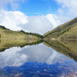 Stock Photo: Delightful reflexion of blue sky in water. Kel-Kogor, mountain lake