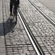 Stock Photo: WomCycling Close to Tram Track