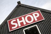 Shop tecken på att bygga fasad — Stockfoto