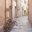 Stock Photo: Disused Bikes in Streets of Pisa, Italy