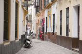 Motorbike in Street in the Santa Cruz Neighbourhood of Seville — Foto de Stock