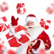 Santa Claus standing and doing magic. Gift boxes falling down ar — Stock Photo #12718757