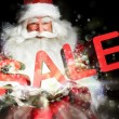 Santa Claus holding his bag and smiling. Lights and sparks are f - Стоковая фотография