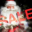 Santa Claus holding his bag and smiling. Lights and sparks are f - Stockfoto