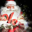 Santa Claus holding his bag and smiling. Lights and sparks are f - Stock Photo