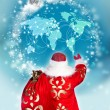 Stock Photo: SantClaus preparing for Christmas. He is looking at digital wo