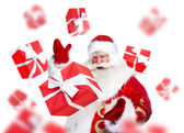 Santa Claus standing and doing magic. Gift boxes falling down ar — Foto de Stock