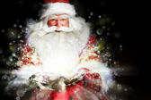 サンタ クリスマスの部屋に座っていると袋に探して — ストック写真