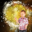 Little boy conjuring with his hands — Foto Stock