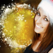 Beautiful woman wearing Santa Claus hat smiling to camera — Foto Stock