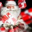 Santa Claus holding his bag and smiling. Gift boxes are flying f — Stock Photo #13177822