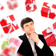 Young man holding money and thinking about gift. — Stock Photo