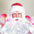 Christmas theme: Santa Claus blowing snowflakes from his arms. D — Stock Photo