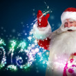 Stock Photo: Santa Claus with 2013 new year number sign