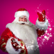 Portrait of Santa Claus conjuring — Stock Photo #13178038