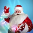 Portrait of Santa Claus conjuring — Stock Photo #13178043
