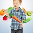 Little boy standing and fruits and vegetables falling around him — Foto Stock
