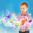 Little boy conjuring toys and confection with his hands — Foto Stock