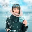 Young woman standing with cup of coffee or tea. Snow on her head — Stock Photo #13251148